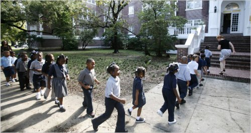 What have the charter schools in New Orleans accomplished, beside forcing students to walk in straight lines?