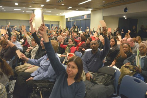 How many delegates dutifully raise their hands every month after getting the UFT's cue?